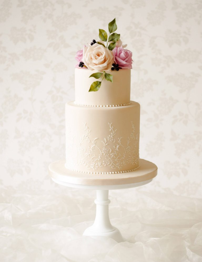 ivory lace wedding cake with flowers in dusky tones