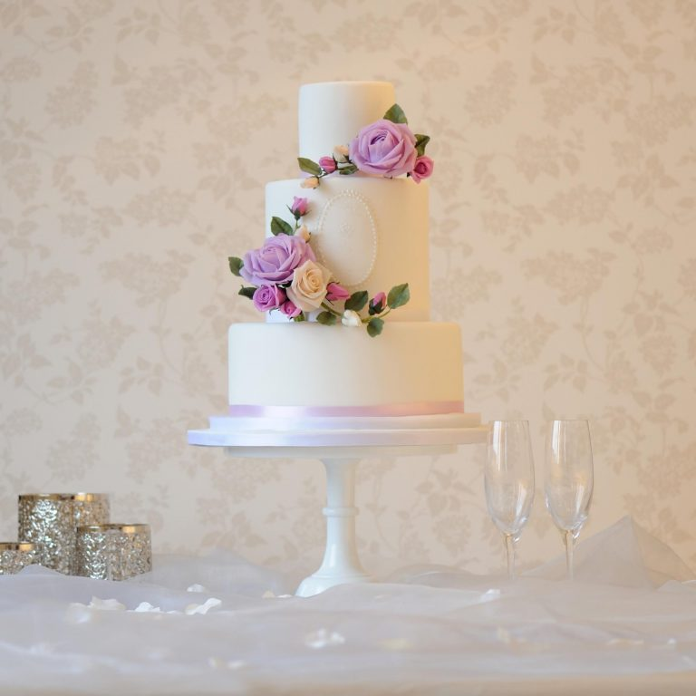 white wedding cake with rose wreath