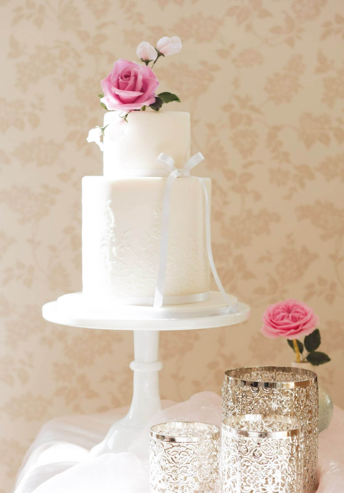 two tier white wedding cake with vine stencilled pattern