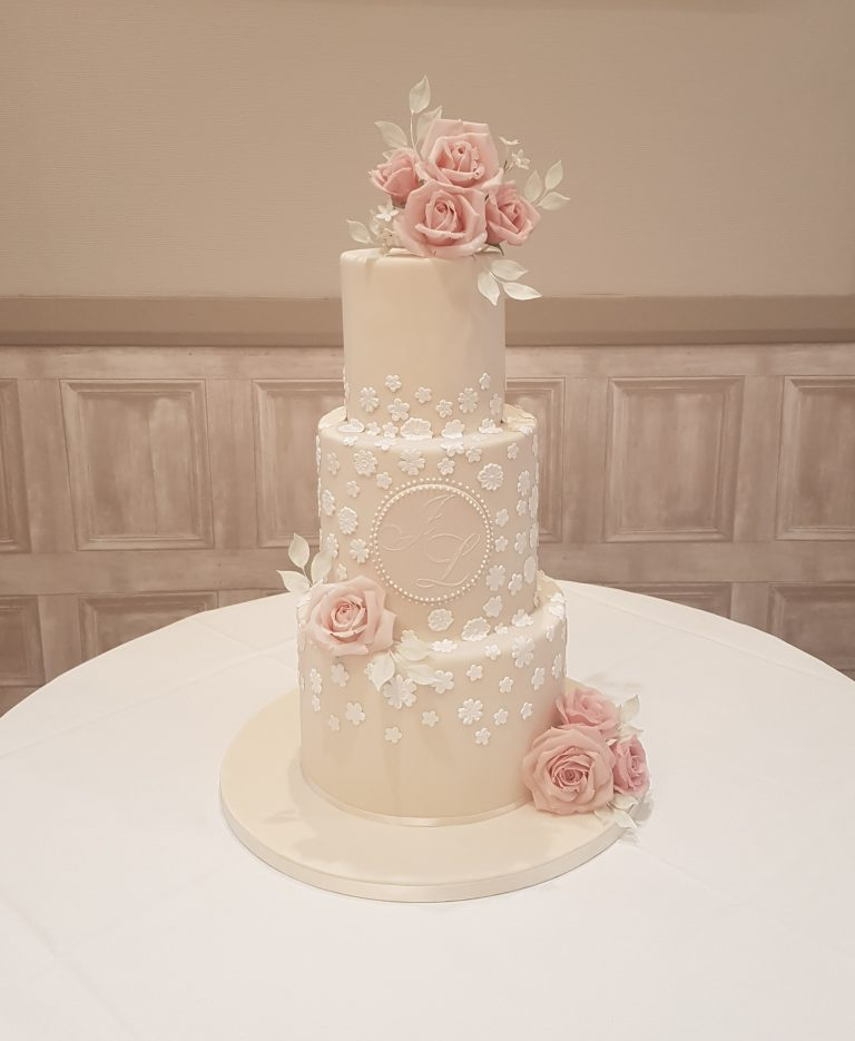 elegant ivory contemporary luxurious wedding cakes in Milton Keynes