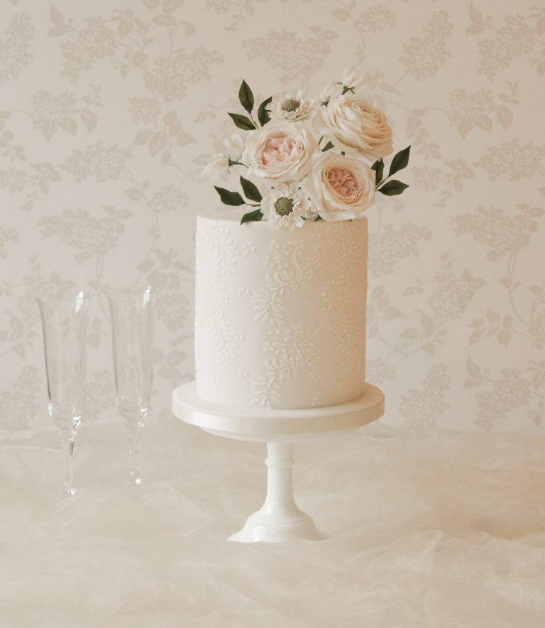 tiered wedding cakes in hertfordshire all white wedding cake with white handmade flowers and white stencilled pattern