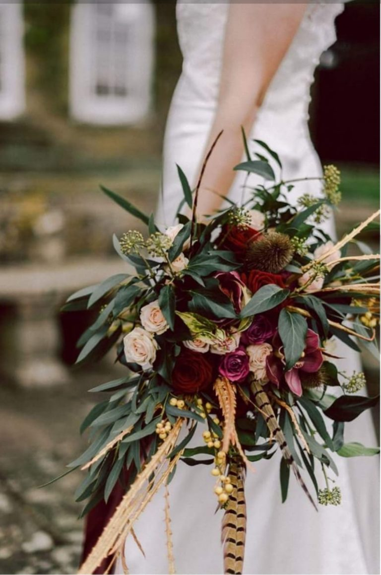 Autumn bouquet inspiration bride in white dress holding autumnal bouquet