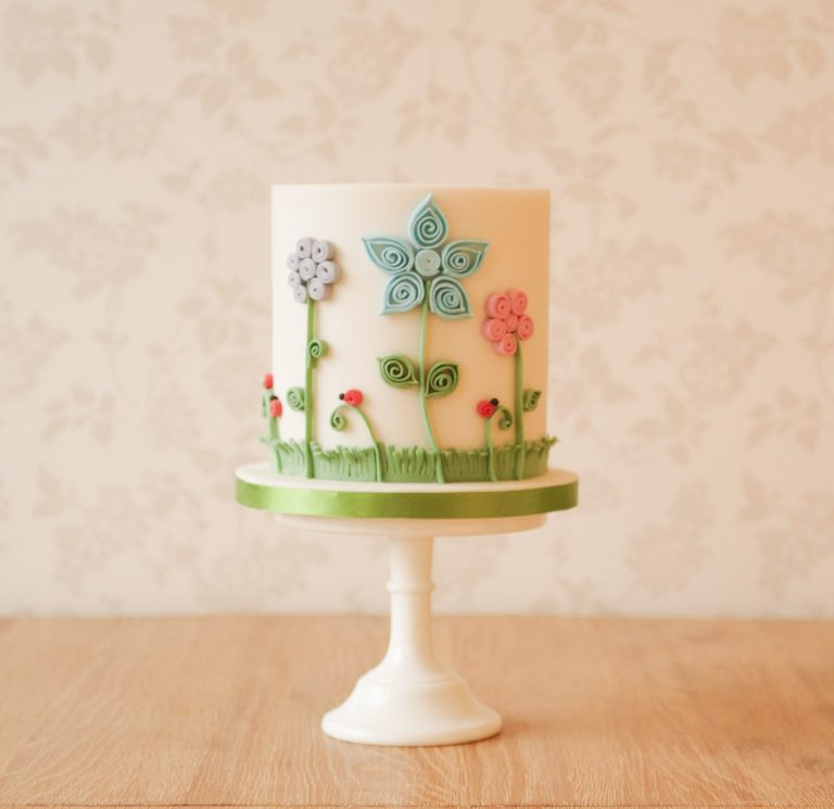 bespoke birthday cakes in milton keynes white cake with colourful quilled flowers