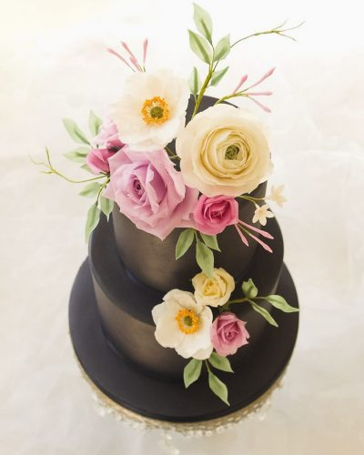 bespoke navy blue wedding cake with handmade flowers