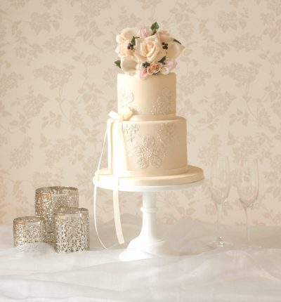 elegant wedding cakes in bedfordshire two tier ivory wedding cake with lace and blush flower bouquet