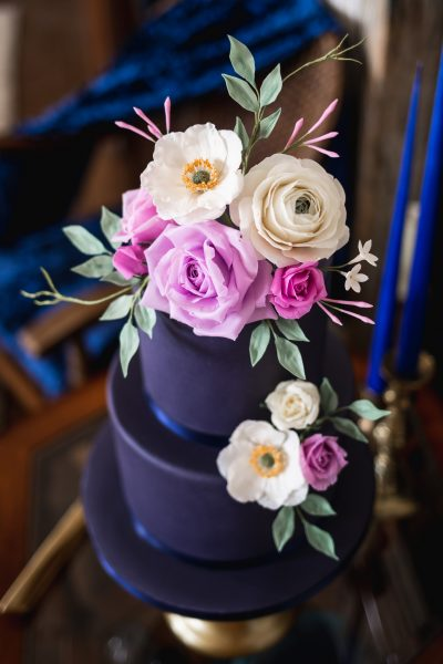 jewel toned two tier cake with handmade flowers