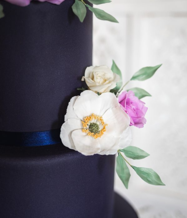 wedding cakes in bedfordshire two tier navy blue cake with handmade flowers