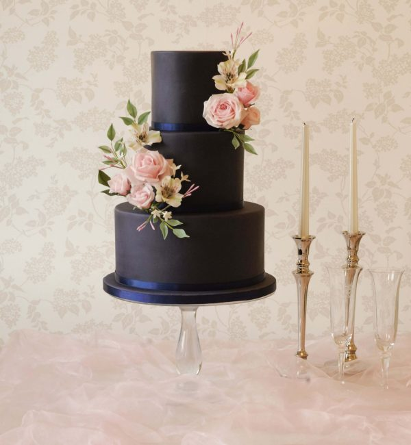 elegant wedding cakes in northamptonshire navy blue wedding cake with pastel handmade flowers