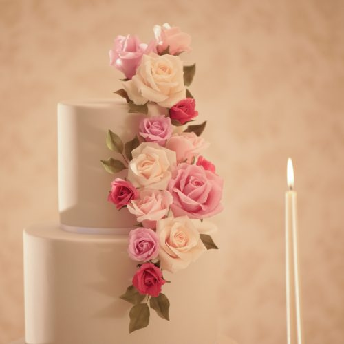 grey wedding cake with pink roses in different shades