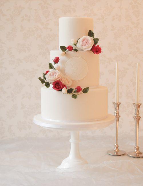 luxury wedding cakes in milton keynes white wedding cake with red and white rose wreath