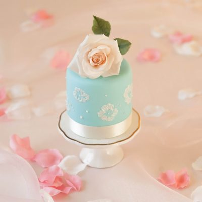 blue mini cake with white rose