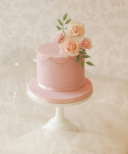 elegant pink birthday cake with gold pearls
