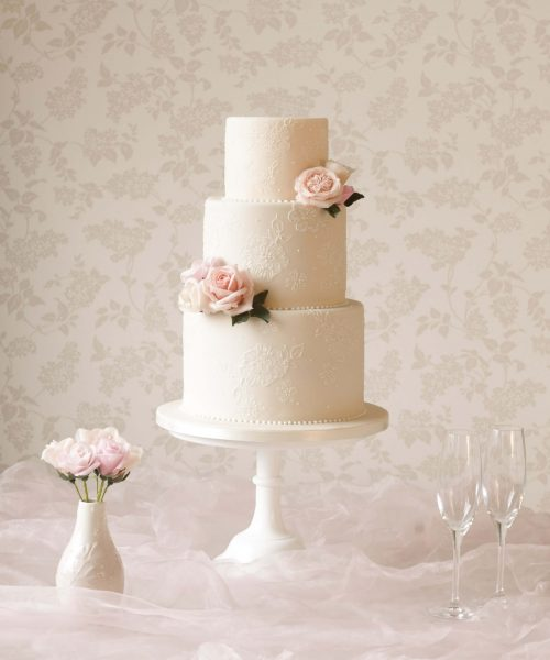ivory lave cake with peach flowers