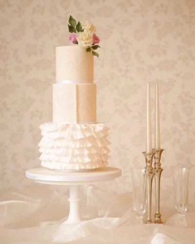 wedding cakes in milton keynes modern white wedding cake with sugar frills
