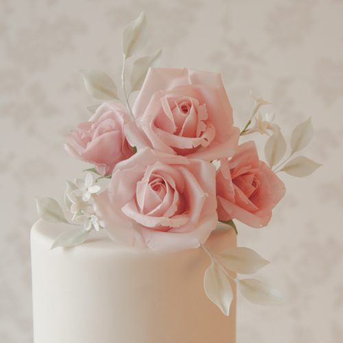 pink-handmade-roses-on-ivory-wedding-cake