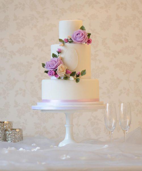 white wedding cake with rose wreath