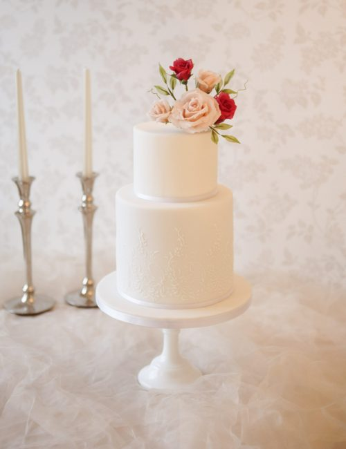 two-tier-white-wedding-cake-with-cream-and-red-handmade-roses