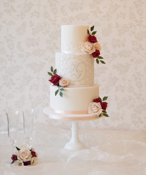 bespoke wedding cakes in milton keynes white lace wedding cake with red and peach handmade roses